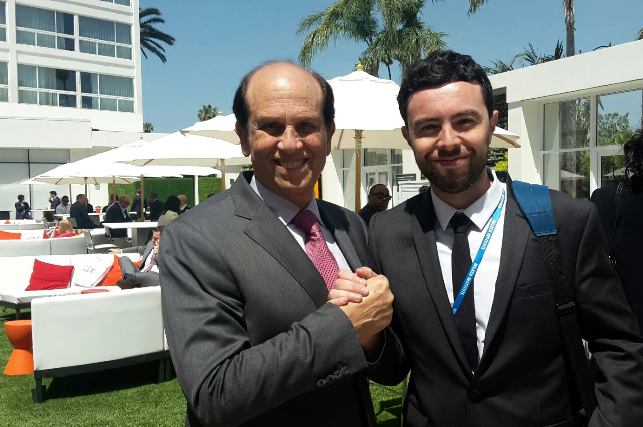 Milken Innovation Center fellow Alex Kleiner meeting Michael Milken during the conference, in a less formal way